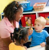 teacher working with preschoolers