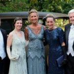 Elegantly dressed guests posing with a classic restored Ford at KET's Fabby Abbey Ball 2019