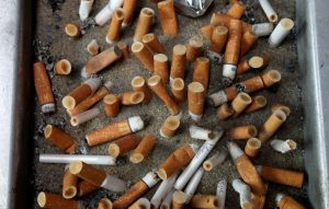 Discarded cigarette butts.