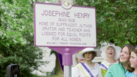 Visitors read a sign honoring suffragist Josephine Henry.