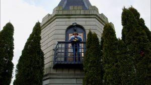 Kentucky Life host Doug Flynn standing on a balcony at the Castle in Versailles, Kentucky