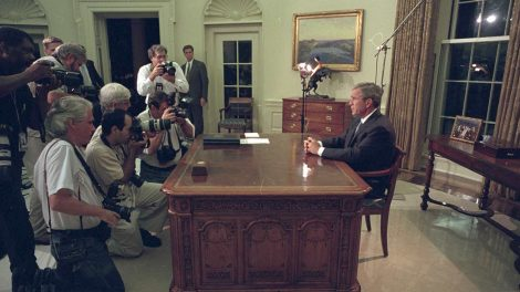 The press pool photographs President George W. Bush as he prepares to address the nation on September 11, 2001.