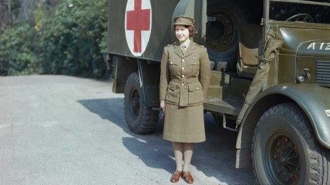 April 1945: Princess Elizabeth, a 2nd Subaltern in the ATS standing in front of an ambulance.