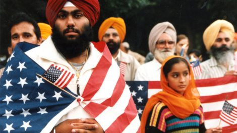 Sikh patriots holding American flags