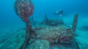 Scuba diver exploring the remains of the underwater remains of a B-54