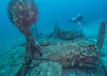 Underwater technology exploring a B-24 Liberator bomber known as the Tulsamerican