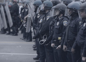 Police officers lined up in riot gear