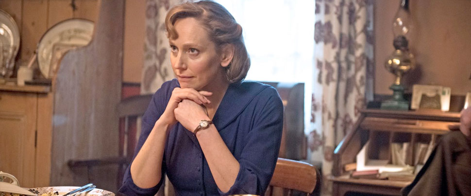 Hattie Morahan as Rose Coyne sitting at a table