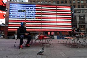 A man wears a protective mask in Times Square.