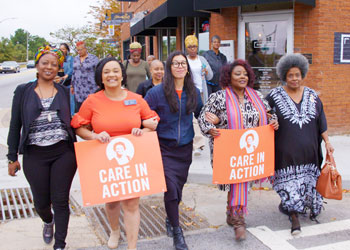 Members of Care in Action, a nonprofit, nonpartisan group dedicated to fighting for dignity and fairness for the millions of domestic workers in the United States, march in support of Georgia gubernatorial candidate Stacey Abrams.