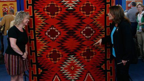 Linda Dyer (right) appraises a Navajo Germantown weaving, ca. 1890, in Philadelphia, Pennsylvania.