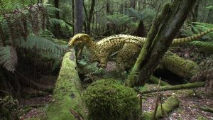 Computer generated image of a dinosaur in a prehistoric Australian forest
