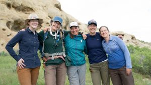 PREHISTORIC ROAD TRIP host Emily Graslie (left) with research group outside Hanna, Wyoming.