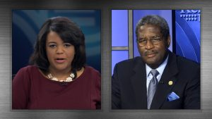 Renee Shaw speaks with Kentucky NAACP chief counsel Raymond Burse.