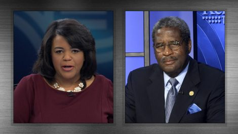 Renee Shaw speaks with Kentucky NAACP chief counsel Raymond Burse.