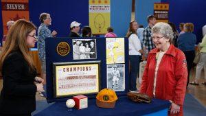 Leila Dunbar (left) appraises a Girls Pro Baseball League collection, ca. 1950, in Eugene, Oregon.