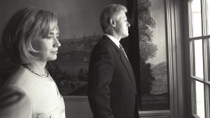 President Clinton and First Lady Hillary Rodham Clinton stand alone and look out a window before the President Kim State Arrival Ceremony. (June 9, 1998)