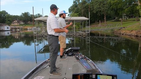 Kentucky Afield host Chad Miles fishing from a dock with a guest