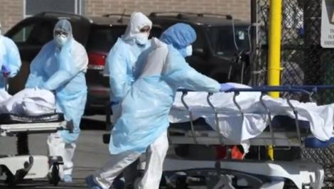 Hospital staff transport patients on stretchers.