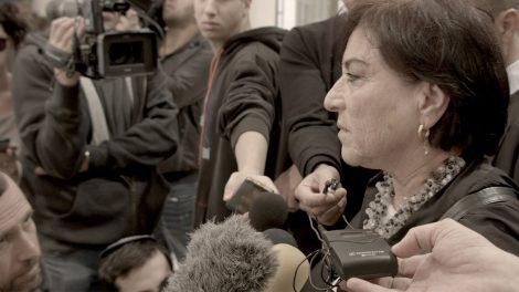 Israeli lawyer Lea Tsemel surrounded by members of the press