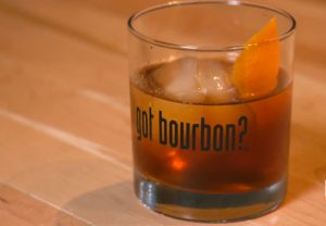 "Old Fashioned cocktail in a ""Got Bourbon?"" glass"