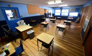 An empty classroom awaits students.