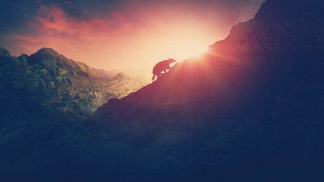 Illustration of an indistinct animal walking up the side of a hill, shown in silhouette