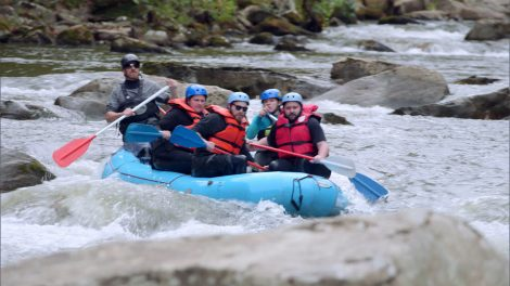A group of white water rafters in action