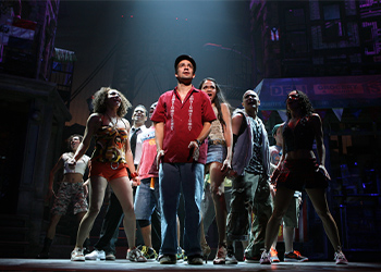 Lin-Manuel Miranda and the cast of In the Heights on stage