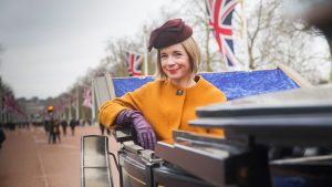 Lucy Worsley in a carriage on The Mall, London.