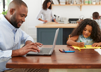 Father and daughter working on learning at home