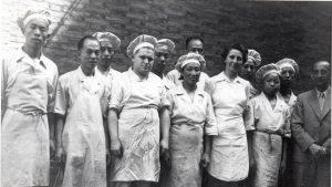 Erwin Louis Eisfelder with Chinese employees circa 1940.