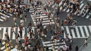 A large number of pedestrians crossing a complicated arrangement of crosswalks