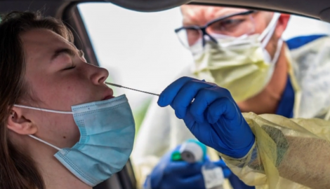 Administering a nasal swab test for COVID-19.