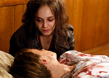 Victoria sitting at the bedside of an injured person