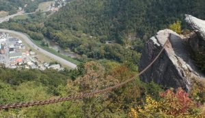 A chain stretching over a hillside to a rock outcropping above Pineville, Kentucky