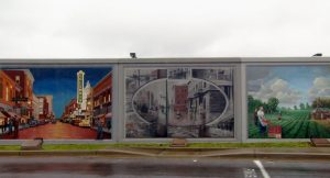 Murals painted on floodwalls along the Ohio River