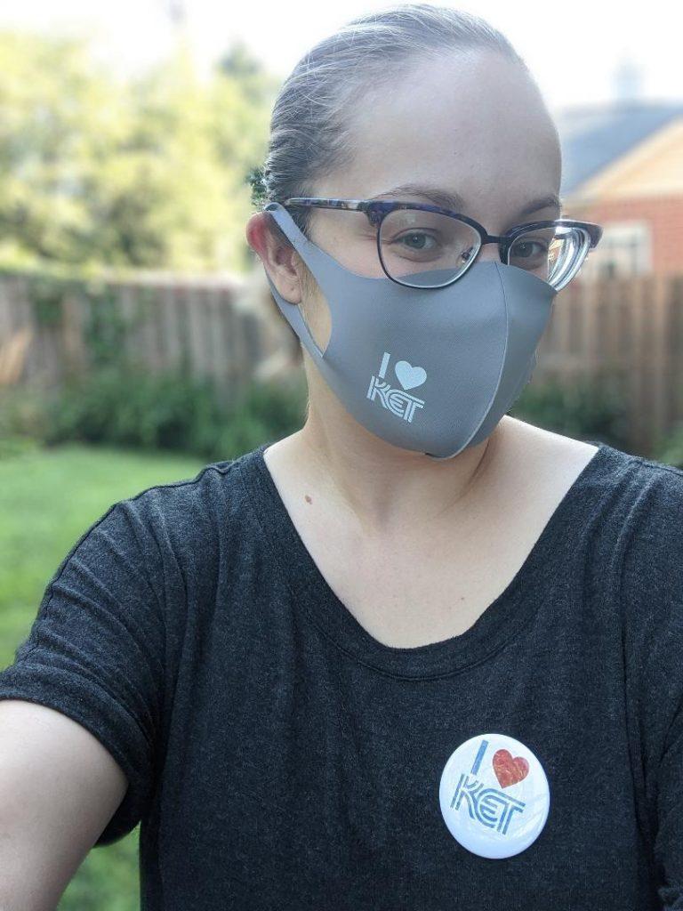 Junior League of Lexington member wearing a KET facemask and button