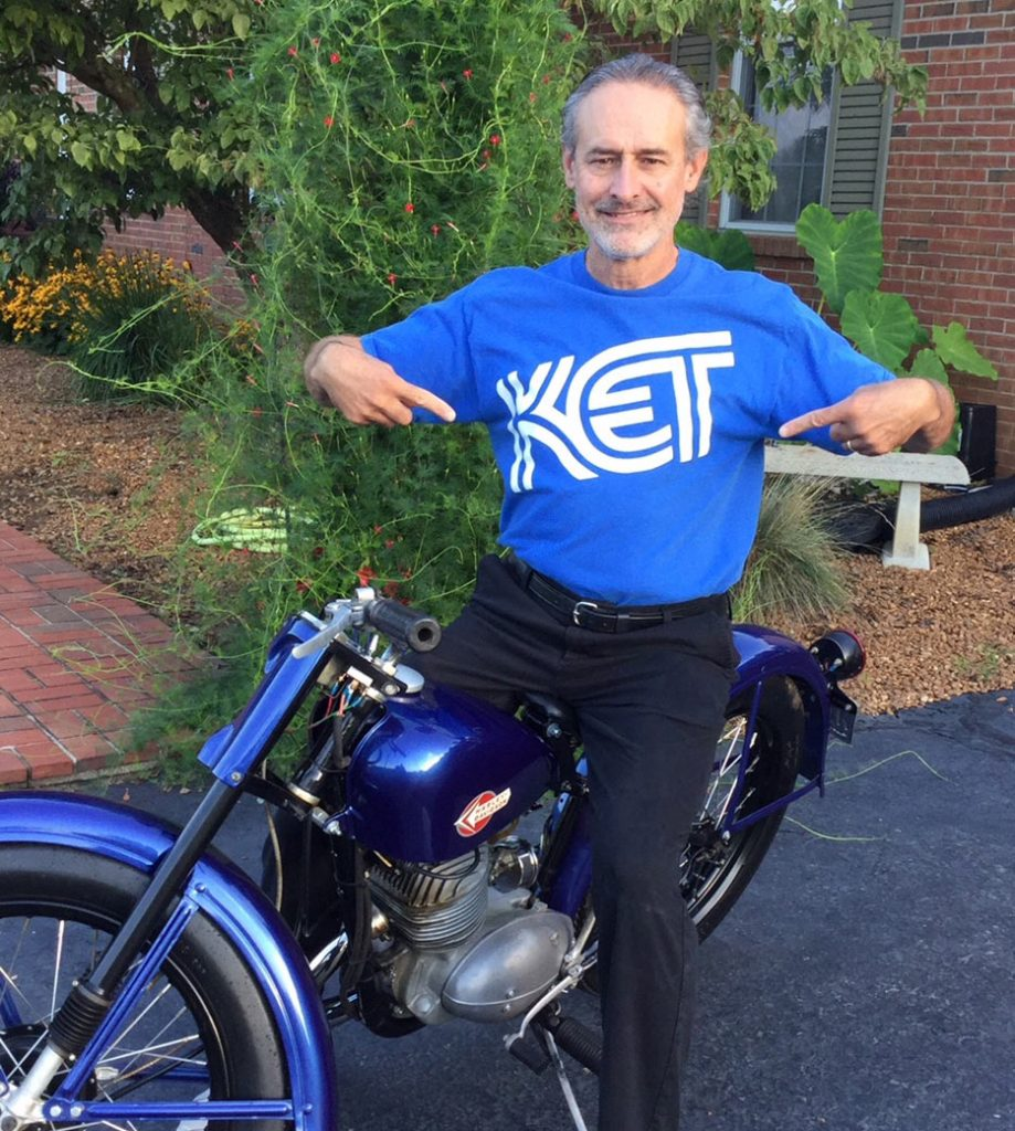 Man with a motorcycle wearing a KET T-shirt