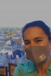 A woman wearing an I heart KET facemask