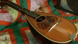 A mandolin set on a quilt
