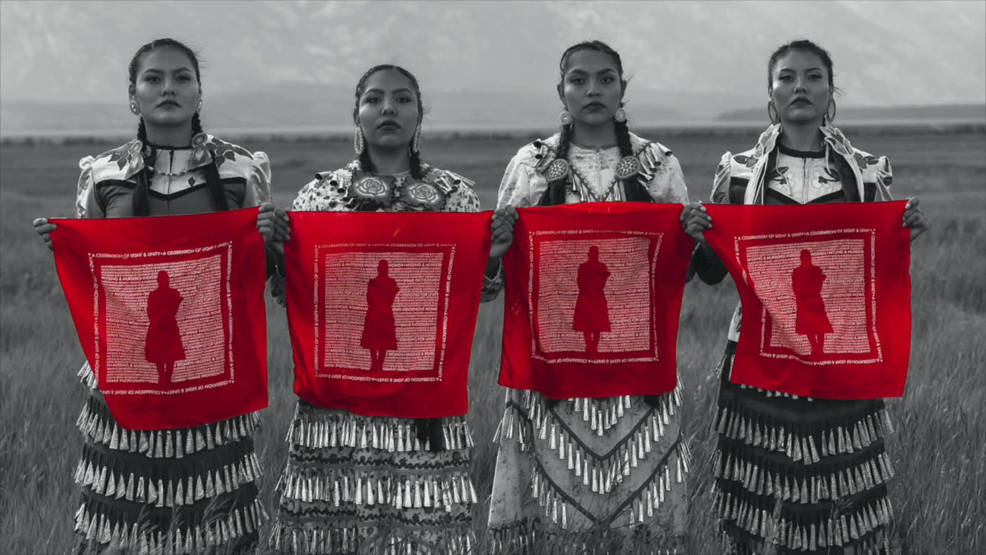 Jingle Dress Dancers hold up a scarf representing Missing and Murdered Indigenous Women. Provo, UT