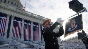 Troop outside capitol with trumpet