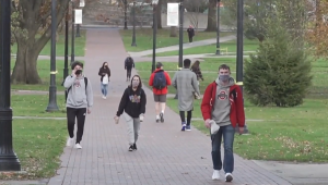 College students walk on campus during the COVID-19 pandemic.