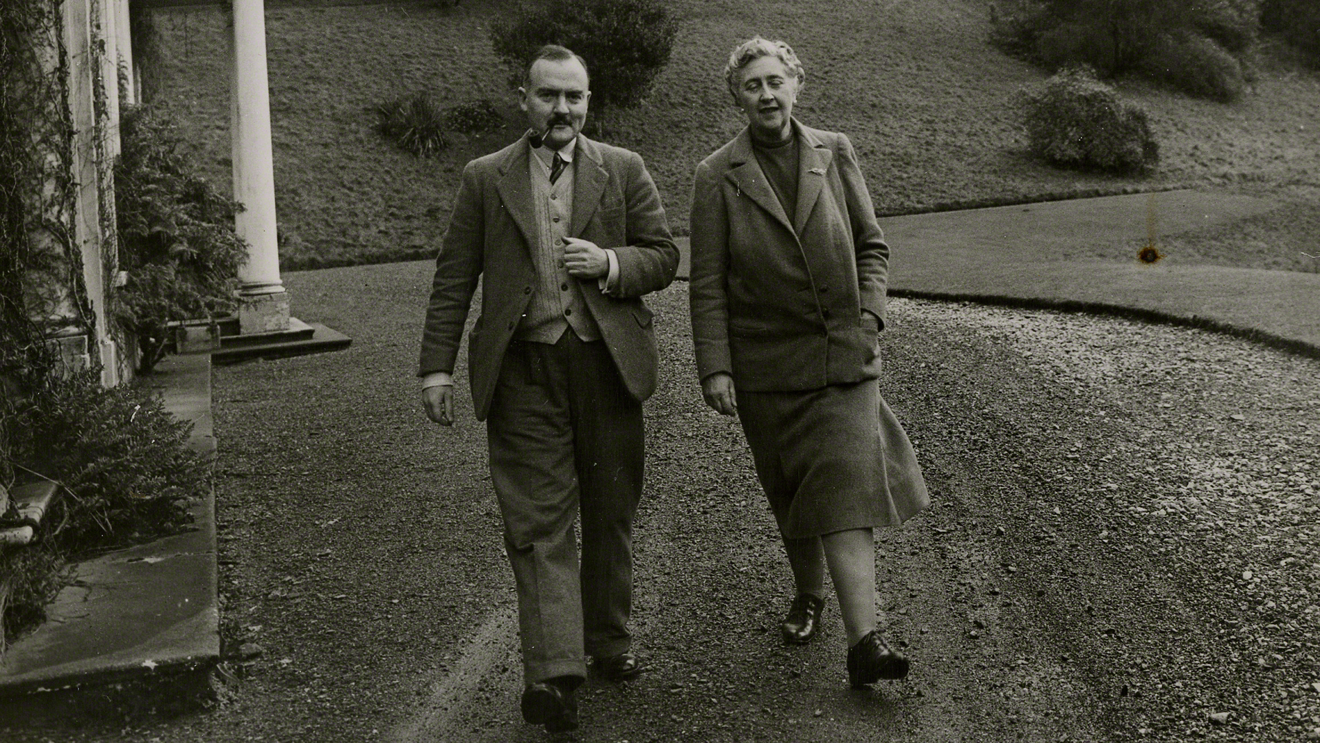 Agatha Christie (right) walks the grounds of Greenway, her beloved country home, with her second husband Max Mallowan.