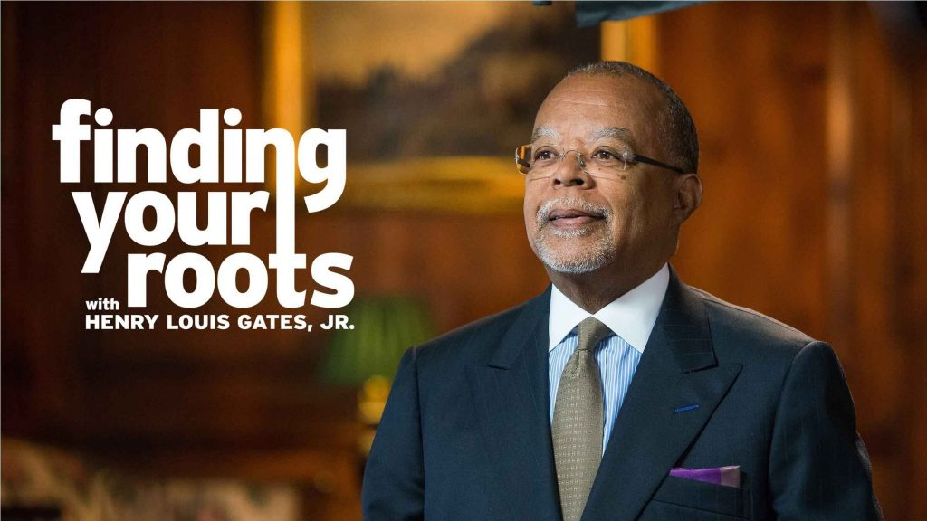 Henry Louis Gates, Jr. in a blue suit coat, blue and white shirt, and a gray tie smiling. The program logo is superimposed over the image.