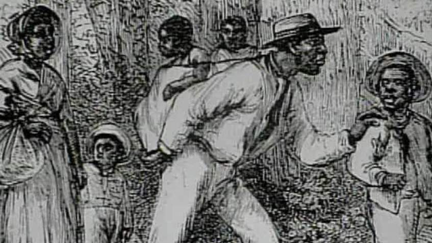 A black-and-white image depicting  six black people on the underground railroad.