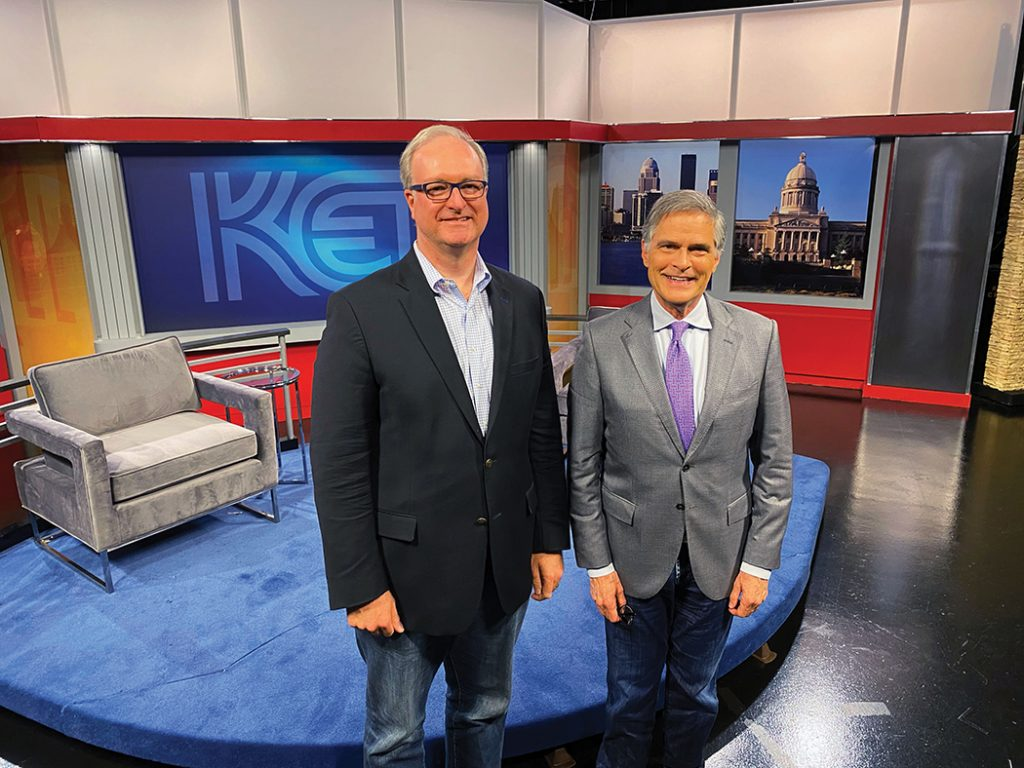 Trey Grayson and Bob Babbage posed and smiling standing on KET's public affairs set.