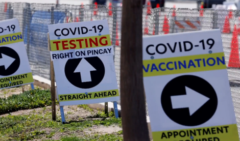 Signs for COVID-19 vaccine sites.