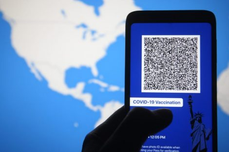 A smartphone reads a code for a vaccine passport.